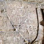 Those who have been healed at Holywell leave their mark on the walls